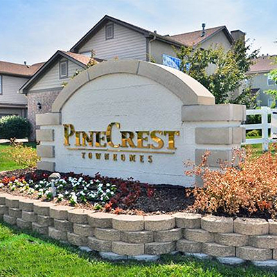 Pinecrest Townhomes in Olathe, KS, is part of NAS' commercial real estate management portfolio